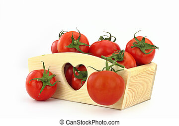 Wooden box full of tomatoes