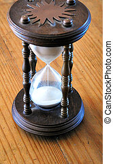 Egg timer hour glass. - Egg timer hour glass in a wooden...