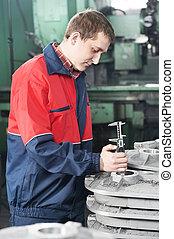 worker measuring detail tool
