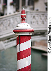 Red and white dock post in Venice - Wooden dock post painted...