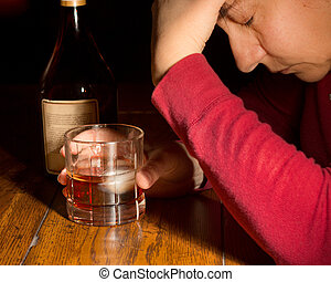 Woman with Whiskey - Dark emotional image of a distressed...