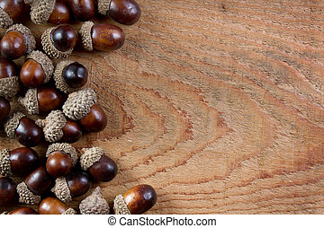 Acorns on a wooden background