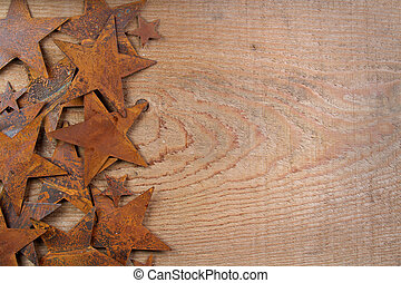 Rusty stars on a wooden background - Rusty starts on a...