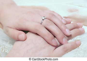 hand with the engagement ring