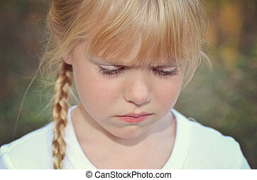 sulking child - Little girl with a pout.