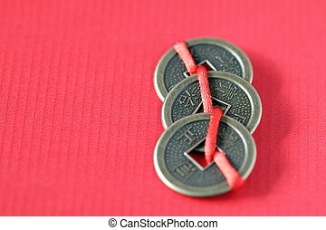Chinese coins on a red string, that bring good luck.