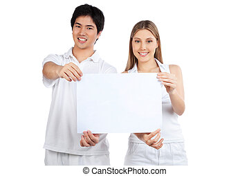 Young Couple  Holding Blank Placard