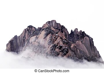 Rocky mountains in the morning fogs - The famous Huangshan...