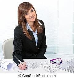 Portrait of cute business woman at desk.