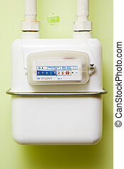 gas meter on the wall in the house.