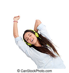 Girl dancing to the beat with headphones.Isolated.