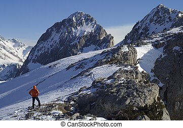 mountaineer against Foratata peak in Tena Valley, Huesca,...