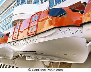 Lifeboats on a Cruise Ship - Closeup of lifeboats on a...