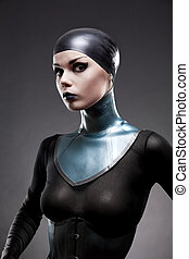 Attractive woman in latex neck corset, studio shot on black...