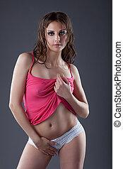 Amazing young go-go dancer posing in wet tank top - Amazing...