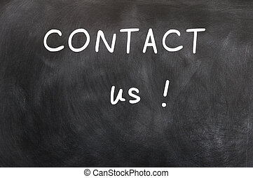 Contact us written with white chalk on a blackboard...