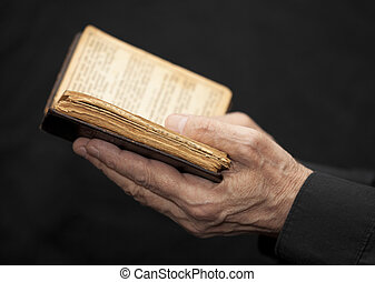 Hands of an old man holding a book - Hands of an old man...