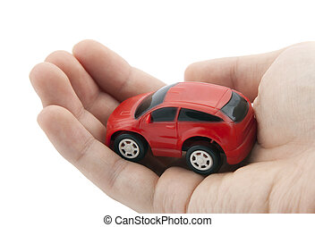 Hand holding a small red car Clipping path included