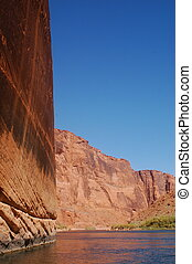 Red Canyon Walls - Steep red rack walls of a canyon seen...