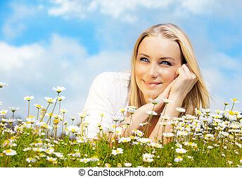 Beautiful woman enjoying daisy field and blue sky, nice...