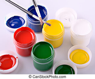 paint - colored acrylic paint containers and paint brushes