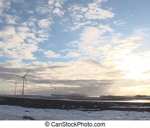 windmills melt snow sky