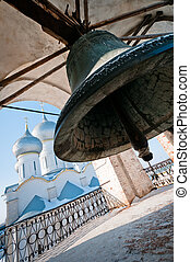 Giant bell with church on background