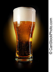 glass of beer - Pint glass of beer amber color with head on...