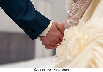 wedding hands - Bride and groom holding hands. Blurred...