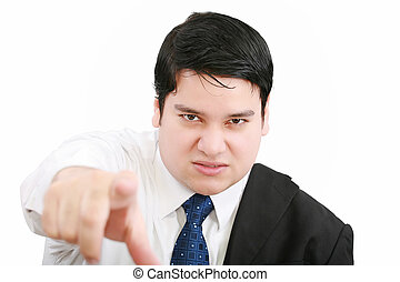 Portrait of an angry young business man in suit pointing at...