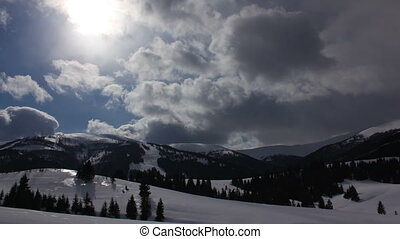 Time-lapse of clouds passing by over winter landscape in Carpathian