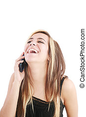 Young beautiful woman bursting out laughing on cellphone.