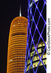 Burj Qatar and the blue illuminated QIPCO Tower in Doha,...