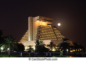 The Sheraton hotel illuminated at night, Doha Qatar. Photo...