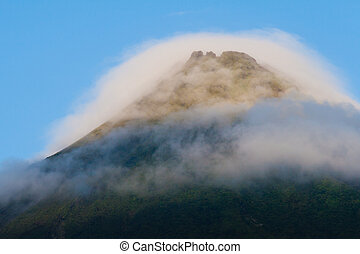Arenal Volcano - Tip of Arenal Volcano in morning light,...