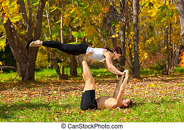 tantra yoga - An attractive man and woman practice tantra...