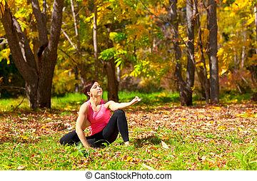 Yoga eka pada yoga dandasana pose - Woman exercises in the...