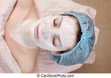 Beautiful woman with clear skin getting beauty treatment of...