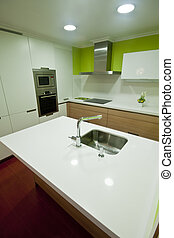 Kitchen Vigo - Modern kitchen with white and wood cupboards...