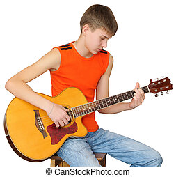 Teen learns to play guitar - Teen chooses chords to a song...