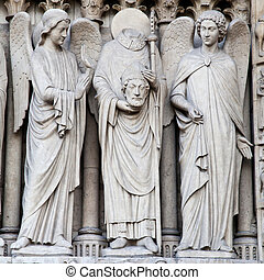 Notre Dame Cathedral - Paris - Detail of gothic Cathedral of...