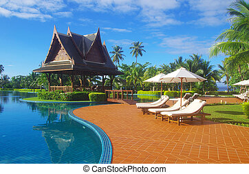 pool - swimming pool with coconut tree and white umbrella