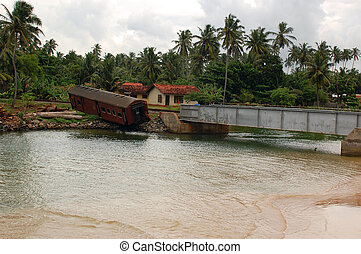 Post-tsunami Landscape in Sri Lanka - Derailed railway car...