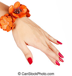 red manicure and orange bracelet - closeup of young woman...