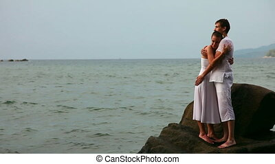 Couple - Happy couple on a rock in a ocean