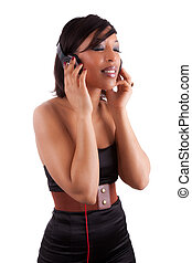 Young beautiful black woman in black dress listening to music