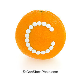 Orange with vitamin c pills over white background - concept