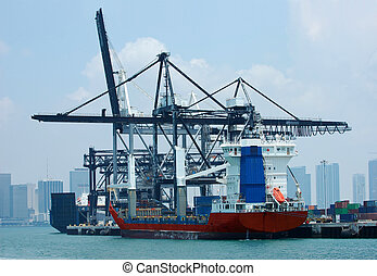 Port - Container port and crane with cruise ships in the...