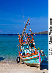 Take a Rest - A small colorful wooden fishing boat is run...