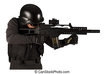 Paintball fighter isolated on white - Armed man in...